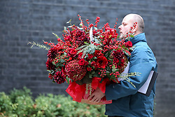 © Licensed to London News Pictures. 10/12/2018. London, UK. A courier with a large bouquet of flowers arrives in Downing Street.  Photo credit: Dinendra Haria/LNP