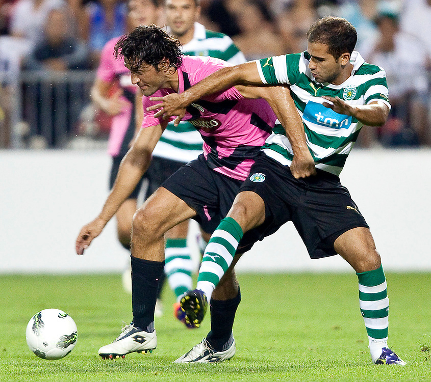 -20110723- Toronto, Ontario,Canada--<br /> Luca Toni of Juventus F.C. fights for possession with Sporting Clube de Portugal's Jao Goncalves in a friendly, part of the Herbalife World Football Challenge, at BMO field in Toronto, Ontario, July 23, 2011.<br /> AFP PHOTO/Geoff Robins