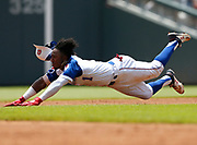 ATLANTA, GA - JUNE 24:  Second baseman Ozzie Albies #1 of the Atlanta Braves slides into second base during the game against the Atlanta Braves at SunTrust Park on Sunday, June 24, 2018 in Atlanta, Georgia. (Photo by Mike Zarrilli/MLB Photos via Getty Images) *** Local Caption *** Ozzie Albies