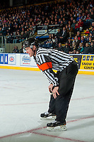 KELOWNA, CANADA - JANUARY 18: Referee Brett Iverson stands on the ice at the Kelowna Rockets against the Moose Jaw Warriors on January 18, 2017 at Prospera Place in Kelowna, British Columbia, Canada.  (Photo by Marissa Baecker/Shoot the Breeze)  *** Local Caption ***