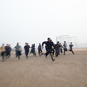 Session de course des élèves de Bhiwani Boxing Club, dans le stade de Bhiwani