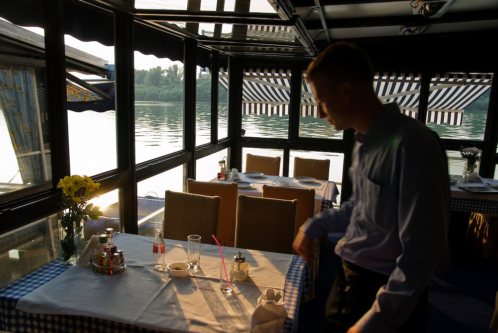 The dining room of the floating restaurant (name to come) known for having the best traditional fish soup (riblja corba) in Belgrade. On the Sava river.