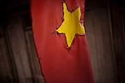 Vietnamese flag hangs outside of a dwelling, Vietnam, Southeast Asia