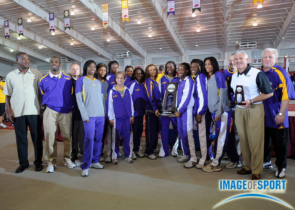 Mar 15, 2008; Fayetteville, AR, USA; The LSU women and coach Dennis Shaver pose with championship plaque after finishing second in the team standings the NCAA indoor track and field championships at the Randal Tyson Center.