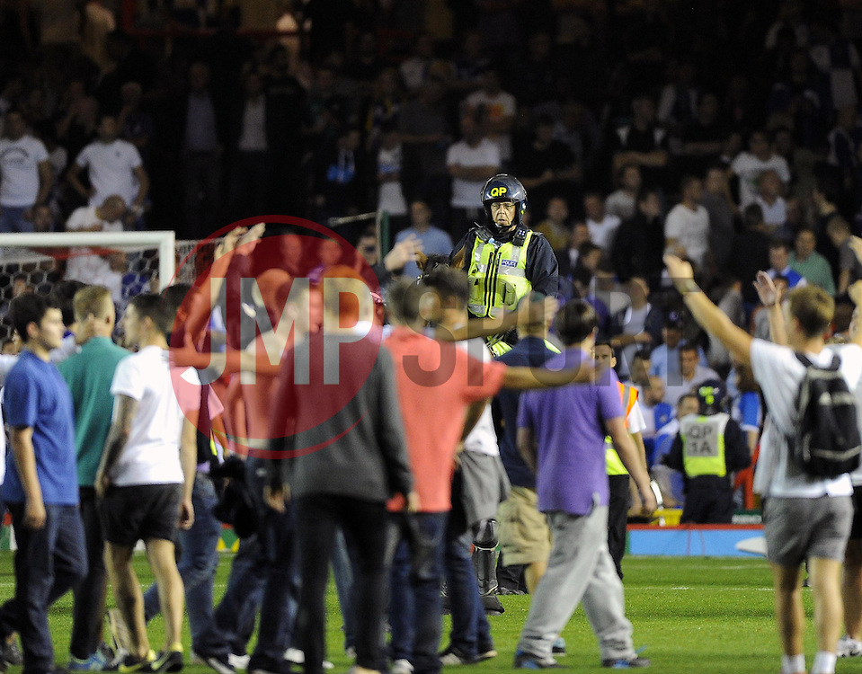 Fans invade the pitch to celebrate but are halted by police horses   - Photo mandatory by-line: Joe Meredith/JMP - Tel: Mobile: 07966 386802 04/09/2013 - SPORT - FOOTBALL -  Ashton Gate - Bristol - Bristol City V Bristol Rovers - Johnstone Paint Trophy - First Round - Bristol Derby