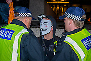 "The gathering in Trafalgar Square is pretty friendly but with a strong police presence and people wearing masks are pulled asside at randon as under public order rules it is now an offence - The Million Mask March - anti-establishment protesters in V for Vendetta-inspired Guy Fawkes masks march from Trafalgar Square to Parliament Square. It was organised by Anonymous, the anarchic 'hacktivist' network. The movement is also closely identified with the Occupy protests, Wikileaks, and the Arab Spring. The UK Anonymous website describes the march on Parliament as a ""protest against austerity … the infringement of our rights … mass surveillance … war crimes … corrupt politicians."" 05 Nov 2016"