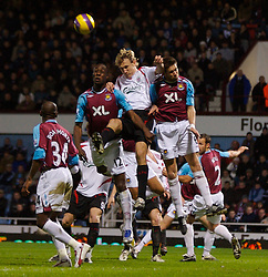 LONDON, ENGLAND - Wednesday, January 30, 2008: Liverpool's Sami Hyypia and West Ham United's Carlton Cole and Matthew Upson during the Premiership match at Upton Park. (Photo by David Rawcliffe/Propaganda)