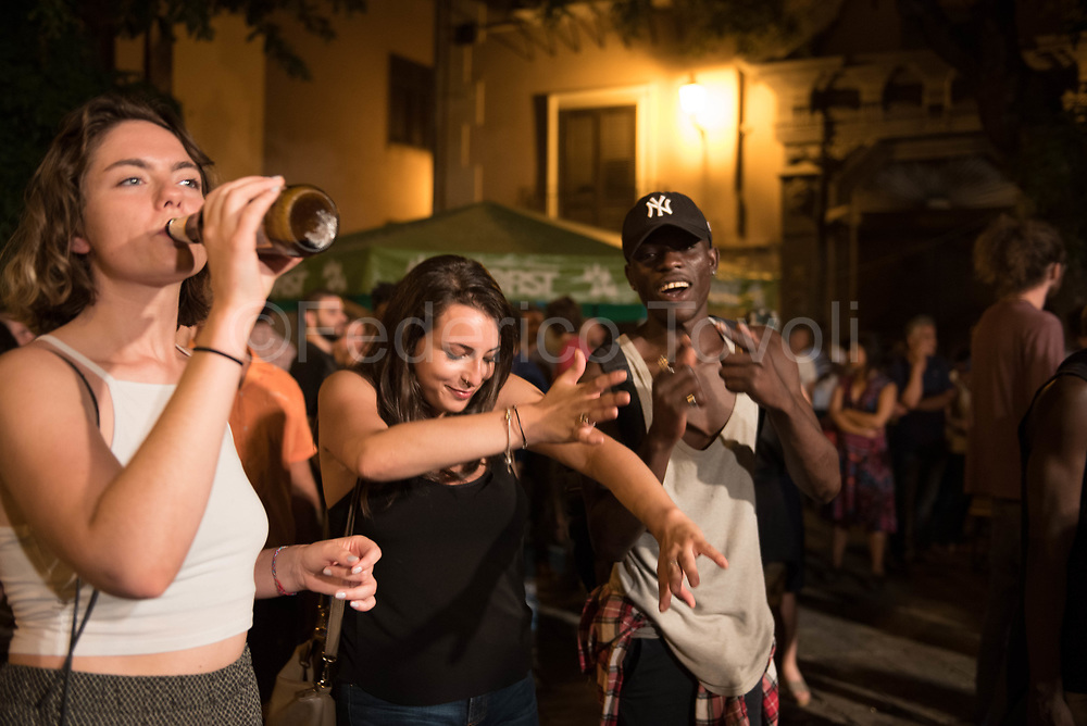 At the closing concert of Mediterranean Antirazzista, in Piazza Profesa in Ballarò, multi-ethnic football championship, young African and Italian dancing together, it is not so common to see it in Italy