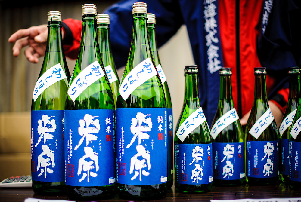 People enjoy sake, a traditional Japanese rice wine, at a brewery in Aisai, Japan.
