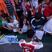 AFC Ajax Defender Vurnon Anita (5) sign autographs after an International friendly match between AFC Ajax and D.C. United, Vurnon scored the winning goal Giving AFC Ajax a 2-1 win...AFC Ajax defeated DC United 2-1 Sunday, May 22, 2011 at  RFK Stadium in Washington DC.