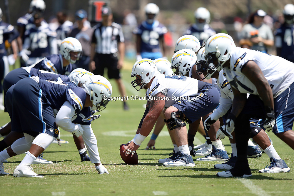 San Diego Chargers center Matt Slauson (68) gets set to snap the ball at the line of scrimmage during the Chargers 2016 NFL minicamp football practice held on Tuesday, June 15, 2016 in San Diego. (©Paul Anthony Spinelli)