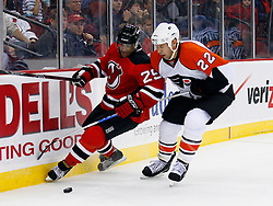 Oct 24, 2008; Newark, NJ, USA; New Jersey Devils defenseman Johnny Oduya (29) and Philadelphia Flyers right wing Mike Knuble (22) battle for the puck during the third period at the Prudential Center. The Flyers defeated the Devils 6-3.