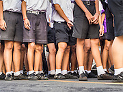 30 OCTOBER 2014 - BANGKOK, THAILAND: Thai high school students march in the parade marking the start of the annual temple fair at Wat Saket. Wat Saket is on a man-made hill in the historic section of Bangkok. The temple has golden spire that is 260 feet high which was the highest point in Bangkok for more than 100 years. The temple construction began in the 1800s in the reign of King Rama III and was completed in the reign of King Rama IV. The annual temple fair is held on the 12th lunar month, for nine days around the November full moon. During the fair a red cloth (reminiscent of a monk's robe) is placed around the Golden Mount while the temple grounds hosts Thai traditional theatre, food stalls and traditional shows.   PHOTO BY JACK KURTZ