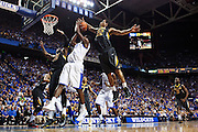 UK forward Alex Poythress, center, has his shot contested by Missouri guard Jabari Brown in the second half. The University of Kentucky Men's Basketball team hosted Missouri , Saturday, Feb. 23, 2013 at Rupp Arena in Lexington .
