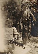 Old photograph of mother and child having fun Japan 1930s