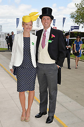 JAKE WARREN and his wife ZOE at the Investec Derby 2015 at Epsom Racecourse, Epsom, Surrey on 6th June 2015.