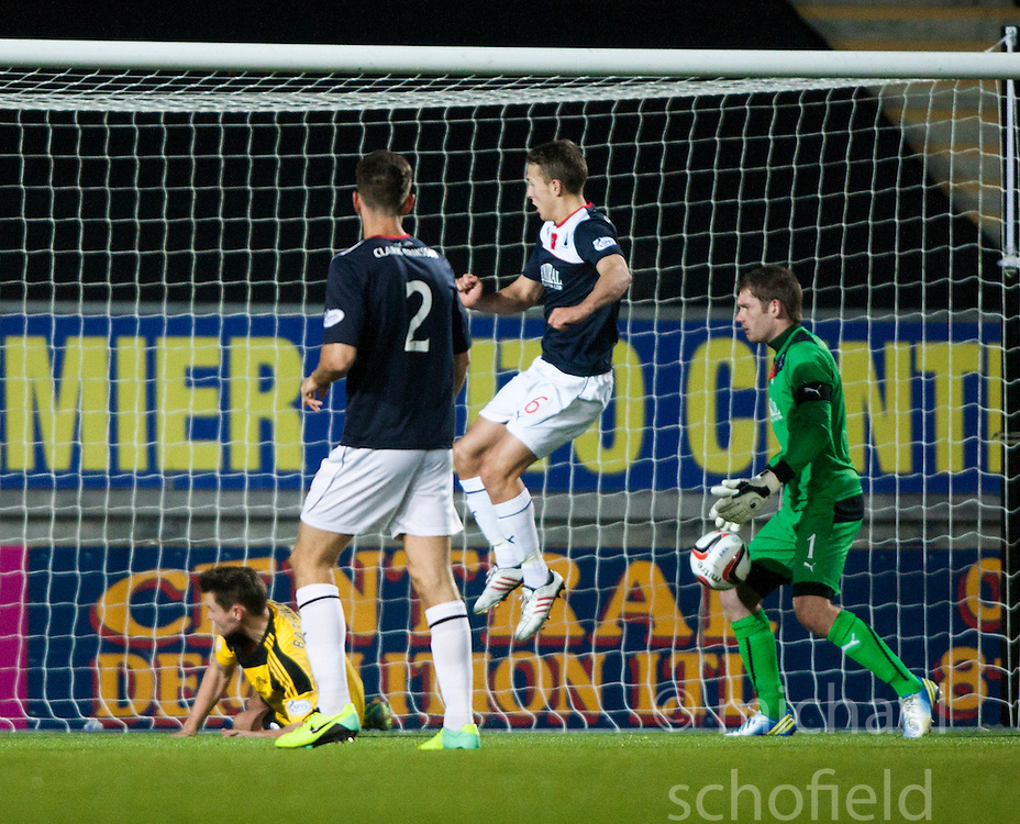 Falkirk's keeper Michael McGovern saves after Will Vaulks clears the ball off  Livingston Andy Barrowman.<br /> Falkirk 4 v 1 Livingston, Scottish Championship game played today at the Falkirk Stadium.