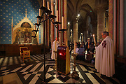 Ceremony of the Veneration of the Crown of Thorns, or Veneration de la Sainte Couronne d'Epines, on Friday 29th March 2019, by the Ordre des Chevaliers du Saint Sepulcre, or the Order of the Knights of the Holy Sepulcher of Jerusalem, guardians of the relics of Christ's Passion since 1920, in the Chapel of the Order of the Holy Sepulcher, in the Cathedrale Notre-Dame de Paris, or Notre-Dame cathedral, built 1163-1345 in French Gothic style, on the Ile de la Cite in the 4th arrondissement of Paris, France. The crown of thorns has been held in Paris since 1239 and at Notre-Dame since 1806, along with a piece of the true cross and a nail from the crucifixion. The crown is held in a tubular reliquary of crystal and gold, with a perforated frame depicting a branch of zizyphus or Spina Christi, made by silversmith M Poussielgue-Rusand, 1861-1933, after drawings by J-G Astruc, 1862-1950. The veneration ceremony usually takes place on the first Friday of each month, every Friday of Lent, and on Good Friday. Picture by Manuel Cohen