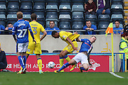 Rochdale FC striker Donal McDermott (12) pulls at AFC Wimbledon defender Darius Charles (32) during the EFL Sky Bet League 1 match between Rochdale and AFC Wimbledon at Spotland, Rochdale, England on 27 August 2016. Photo by Stuart Butcher.