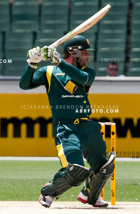 Phil Hughes plays a cut shot while batting during game 1 of the Commonwealth Bank Series Australia v Sri Lanka played at the Melbourne Cricket Ground in Melbourne,Victoria, Australia. Photo Asanka Brendon Ratnayake