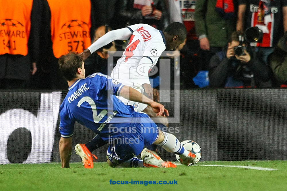 Branislav Ivanovic of Chelsea fouls Blaise Matuidi of Paris Saint-Germain right on the edge of the area during the UEFA Champions League match at Stamford Bridge, London<br /> Picture by Paul Chesterton/Focus Images Ltd +44 7904 640267<br /> 08/04/2014