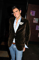 OSCAR HUMPHRIES at a party to celebrate a new collection of sexy underware by Janet Reger called 'Naughty Janet' held at 5 Cavendish Square, London on 19th October 2004.<br />