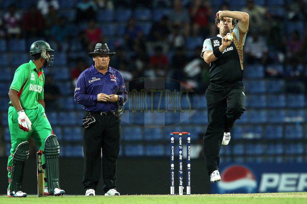 Jacob Oram bowls during the ICC World Twenty20 Pool match between New Zealand and Bangladesh held at the  Pallekele Stadium in Kandy, Sri Lanka on the 21st September 2012..Photo by Ron Gaunt/SPORTZPICS/PHOTOSPORT