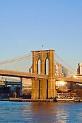 The Brooklyn Bridge and the East River in afternoon sunlight, Brooklyn, New York City.