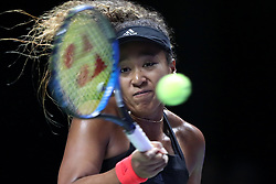 October 22, 2018 - Singapore, Singapore - Naomi Osaka of Japan returns a shot during the match between Naomi Osaka and Sloane Stephens on day 2 of the WTA Finals at the Singapore Indoor Stadium. (Credit Image: © Paul Miller/ZUMA Wire)