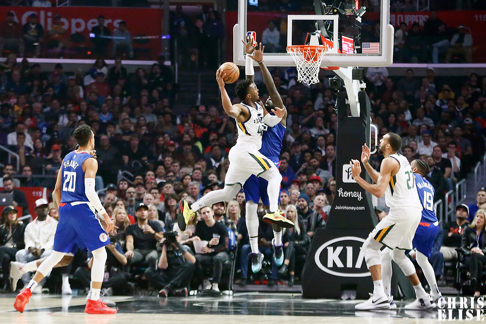 LOS ANGELES, CA - NOV 3: Donovan Mitchell (45) of the Utah Jazz shoots the ball against Montrezl Harrell (5) of the LA Clippers during a game on November 3, 2019 at the Staples Center, in Los Angeles, California.