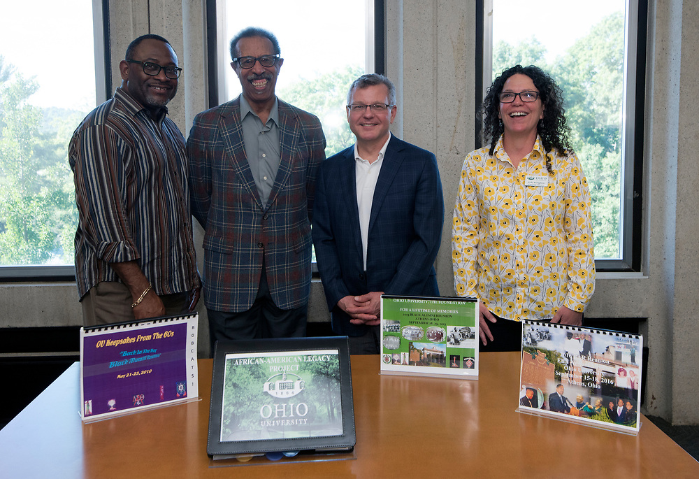 (left to right) Tyrone Carr, director of Interlink Alliance/special assistant to the vice president for Diversity and Inclusion; alumnus Ralph Hopper; Scott Seaman, dean of University Libraries; and Kelly Broughton, assistant dean for research and education services, pose in front of the African American Legacy Project.  (Photo by Delia Palmisano/Ohio University Libraries)