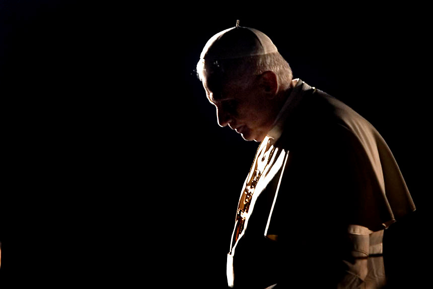 "Pope Benedict XVI celebrates the Via Crucis, ""Way of the Cross"" at Rome's Colosseum."
