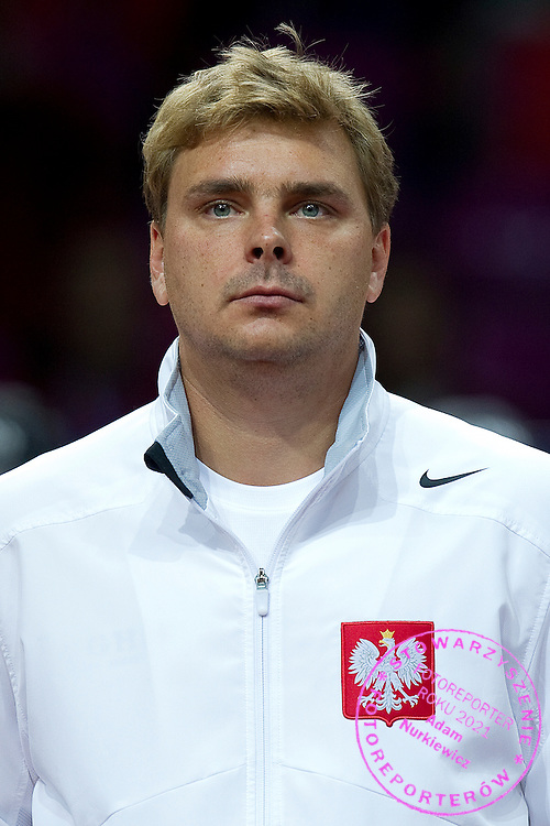 Marcin Matkowski of Poland while national anthem before the BNP Paribas Davis Cup 2013 between Poland and Australia at Torwar Hall in Warsaw on September 13, 2013.<br /> <br /> Poland, Warsaw, September 13, 2013<br /> <br /> Picture also available in RAW (NEF) or TIFF format on special request.<br /> <br /> For editorial use only. Any commercial or promotional use requires permission.<br /> <br /> Photo by © Adam Nurkiewicz / Mediasport
