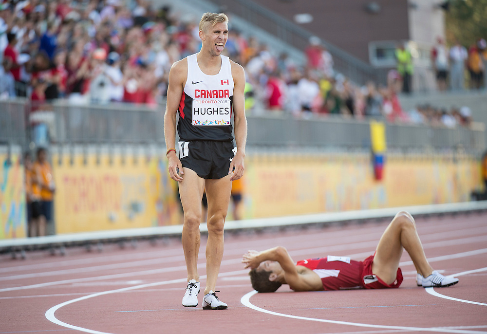 Matt Hughes, of Canada after his gold medal performance in the men's 3000 meter steeplechase during athletics competition at the 2015 PanAm Games in Toronto.