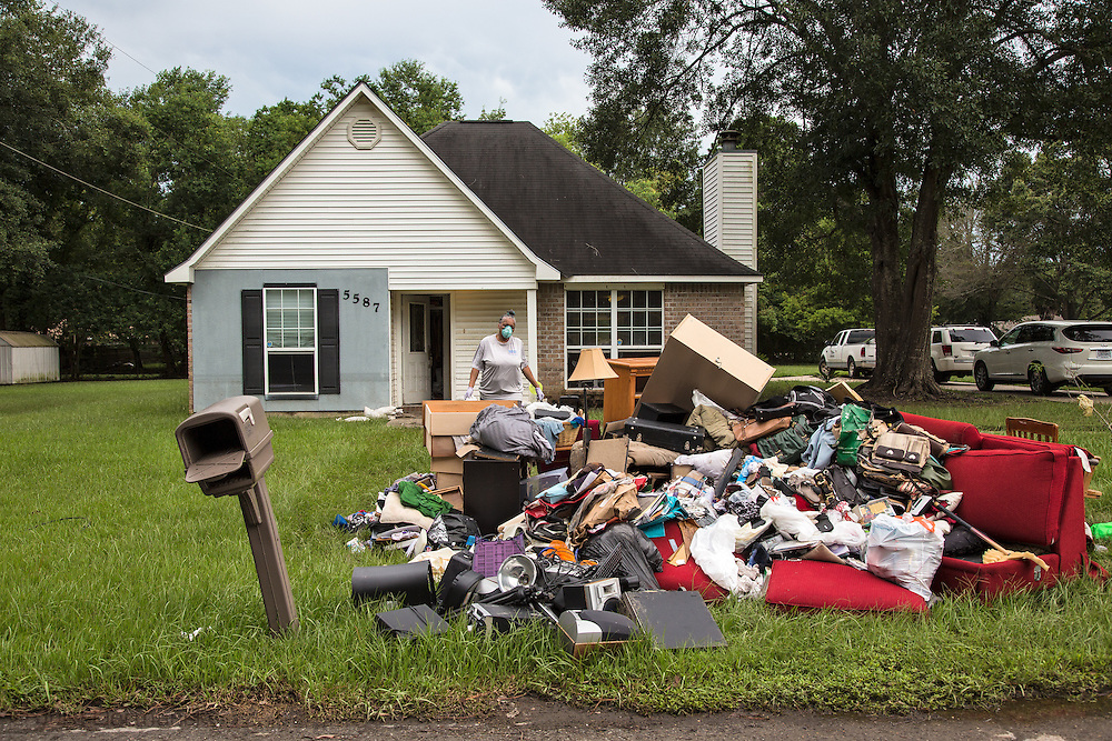 Esther Williams-Moore cleaning things she is able to save from herbadly flooded hom in Glen Oaks Baton Rouge, an African American Neighborhood that was badly hit by the historic Louisiana floods