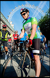 Image ©Licensed to i-Images Picture Agency. 22/06/2014. London, United Kingdom. Cyclist gather at the London Eye for the start of the Capital To Coast (London-Brighton) Bike Ride. The cyclist raise thousands for 3 charities Norwood, The Down's Syndrome Association and Action Medical Research. Picture by Andrew Parsons / i-Images<br /> <br /> For more info contact Kerry Milliken 07799714006