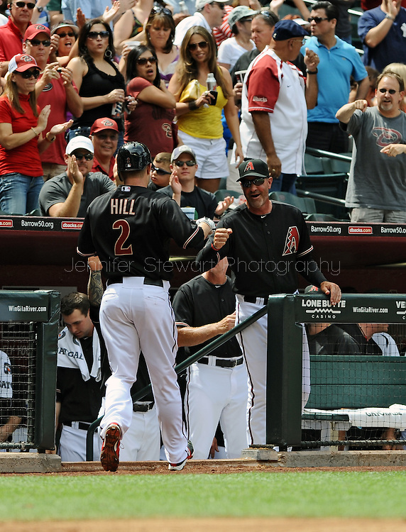 Apr. 7, 2012; Phoenix, AZ, USA; Arizona Diamondbacks second basemen Aaron Hill (2) is congratulated by manager Kirk Gibson after he hits a two run home run against the San Francisco Giants during the second inning at Chase Field.  Mandatory Credit: Jennifer Stewart-US PRESSWIRE