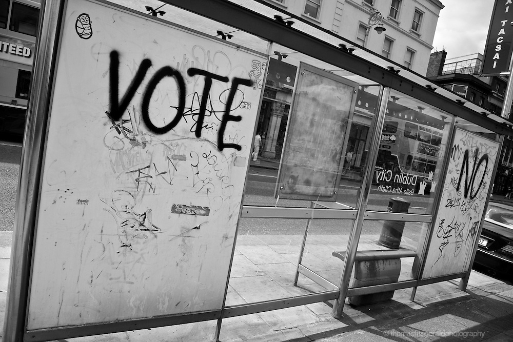 "The Words ""Vote No"" are spray painted on a Dublin City bus shelter in an act of graffiti protesting an upcoming referendum"