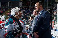 KELOWNA, CANADA - APRIL 7: Assistant coach Kris Mallette and Devante Stephens #21 of the Kelowna Rockets share a laugh on the bench against the Portland Winterhawkson April 7, 2017 at Prospera Place in Kelowna, British Columbia, Canada.  (Photo by Marissa Baecker/Shoot the Breeze)  *** Local Caption ***
