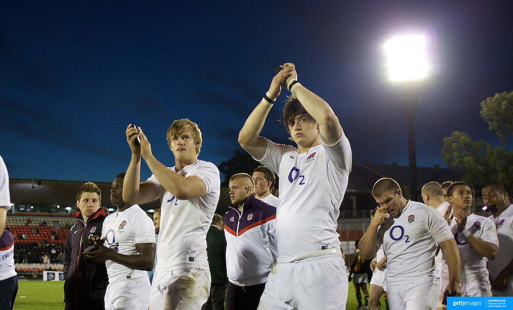 England players after their defeat during the England V South Africa third place play off match at Estadio El Coloso del Parque, Rosario, Argentina, during the IRB Junior World Championships. 21th June 2010. Photo Tim Clayton...