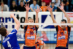 Jernej Potocnik of Salonit vs Veljko Petkovic and Matej Vidic of ACH at final match of Slovenian National Volleyball Championships between ACH Volley Bled and Salonit Anhovo, on April 24, 2010, in Radovljica, Slovenia. ACH Volley defeated Salonit 3rd time in 3 Rounds and became Slovenian National Champion.  (Photo by Vid Ponikvar / Sportida)