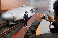 Chinese families like to photograph each other in front of the Chinese high-speed train at Shanghai Expo fair in April 2010.