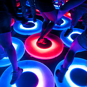 """May 17, 2013 - Queens, NY :  Festivalgoers dance on interactive light-up panels that comprise Jen Lewin's interactive sculpture """"The Pool"""" during the first day of the 2013 New York 'Electric Daisy Carnival,' an electronic dance music festival, at Citi Field in Queens, on Friday. CREDIT: Karsten Moran for The New York Times CREDIT: Karsten Moran for The New York Times"""