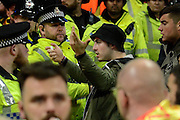Sevilla fan argues with Man City fan during the Champions League Group D match between Manchester City and Sevilla at the Etihad Stadium, Manchester, England on 21 October 2015. Photo by Alan Franklin.