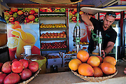 Israel, Haifa, a fruit juice kiosk man squeezes oranges