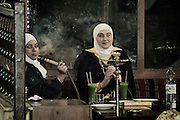 Two girls smoking waterpipe in a Syrian restaurant