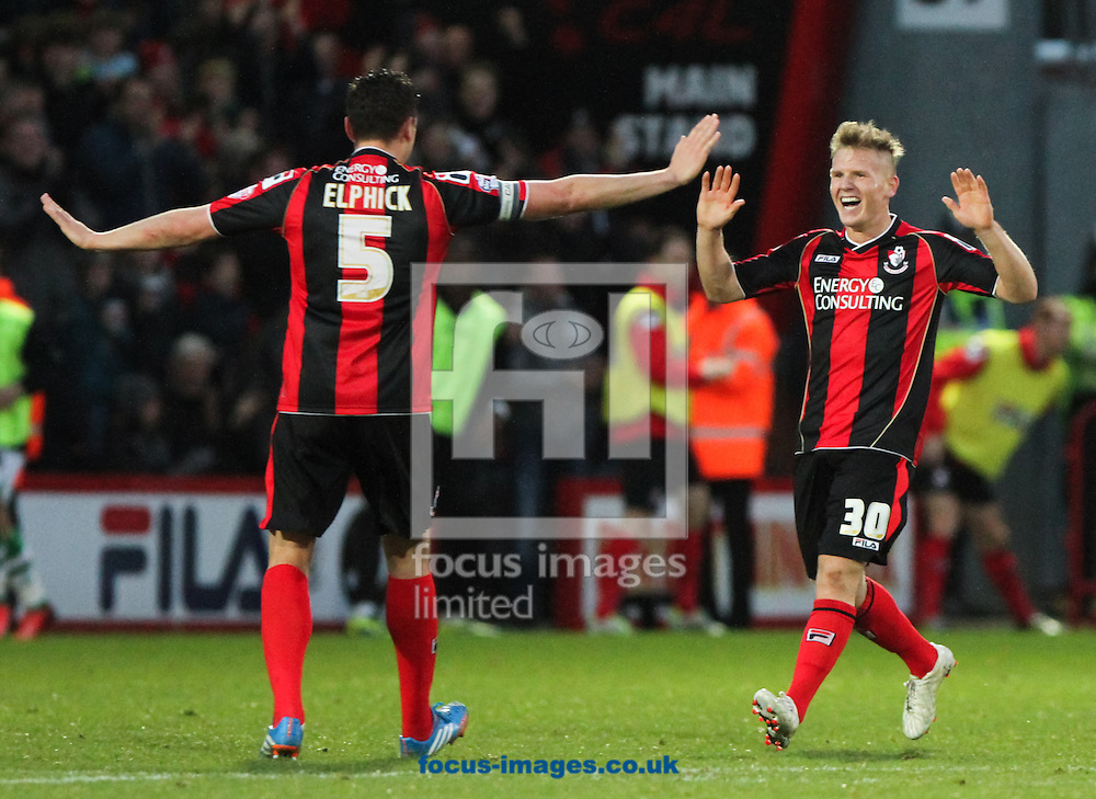 Picture by Tom Smith/Focus Images Ltd 07545141164<br /> 26/12/2013<br /> Matt Ritchie (right) of Bournemouth runs over to Tommy Elphick (left) of Bournemouth in celebration of scoring the goal to make it 2-0 to his side during the Sky Bet Championship match at the Goldsands Stadium, Bournemouth.