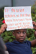 A young girl hold a sign during a vigil outside the North Charleston City Hall following the shooting death of Walter Scott April 10, 2015 in Charleston, South Carolina. Scott was shot multiple times by police after running from a traffic stop.