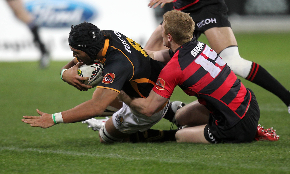 Wellington's Victor Vito scores a try in the tackle of Canterbury's  Johnny McNicholl in the ITM Cup rugby game at the Westpac Stadium, Wellington, New Zealand, Wednesday,  July 27, 2011. Credit:SNPA/Marty Melville