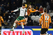 Barnsley FC player Kieffer Moore (19) and Hull City defender Michael Dawson (21) during the EFL Sky Bet Championship match between Hull City and Barnsley at the KCOM Stadium, Kingston upon Hull, England on 27 February 2018. Picture by Ian Lyall.